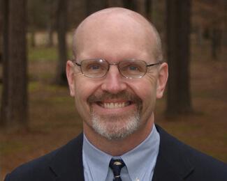 Dr. John L. Ward